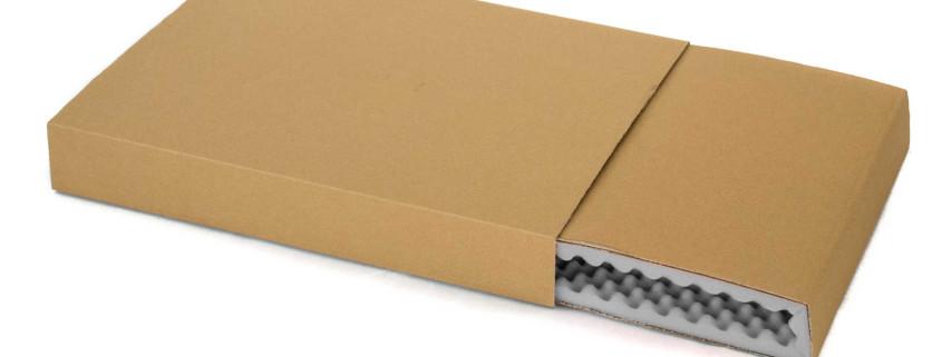 Zweiteilige Noppenschaumverpackung in grau und Umkarton