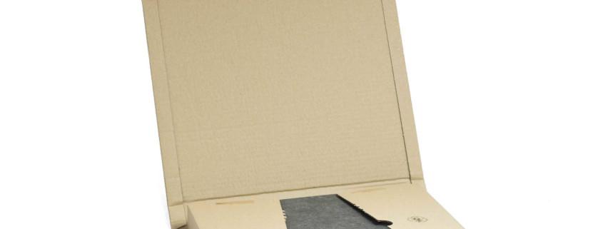 Ordnerverpackung mit Schnellklebeverschluss